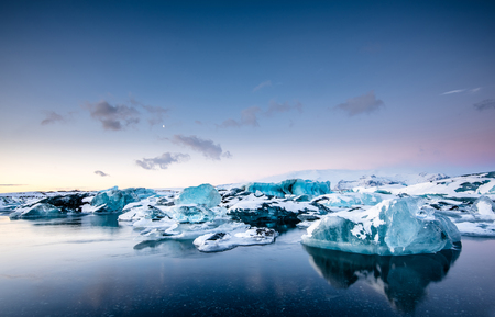 berg: icebergs at crystal black beach in south Iceland Stock Photo