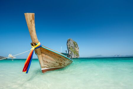 phuket province: Cliff and boat in the amazing beach in tropical island in Krabi, Phuket, Thailand