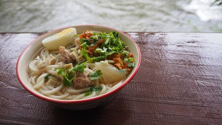 side view of noodles on wooden background.