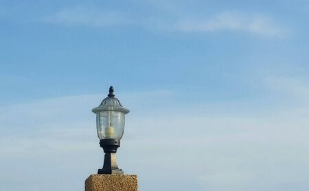 metal: Bulb on blue sky, dramatic feeling alone. Stock Photo