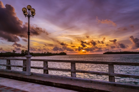 Sun set at sarasin Bridge , Phang Nga photo