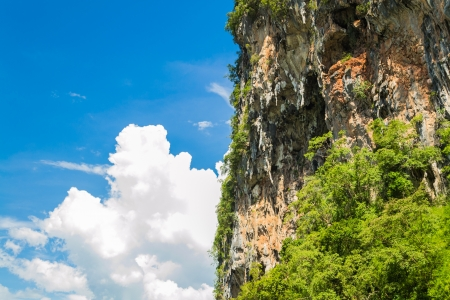 eminent: Rocky cliff with blue sky