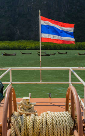 escort: Thai nation flag is on a escort boat Stock Photo