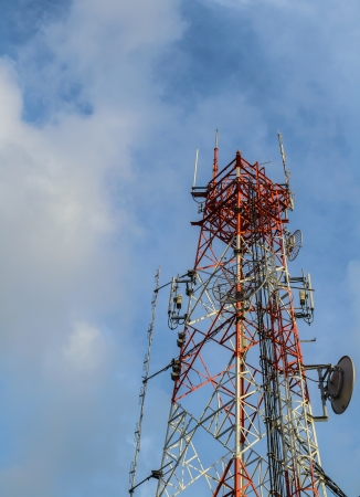 Mobile phone communication repeater antenna tower with cloudy blue sky Stock Photo - 16939442