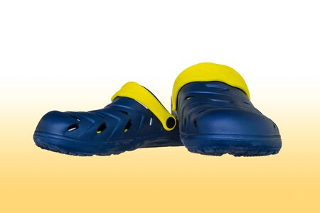 floatable: A pair of shoe is isolated on white and yellow