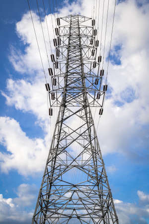 A high- voltage tower with blue sky photo