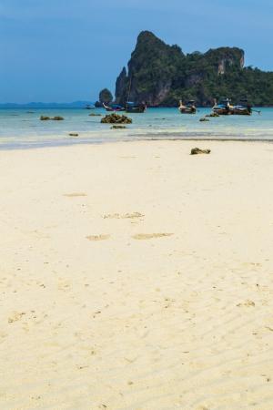 White sand beach with blue sky at Phi Phi Island, Krabi, Thailand photo