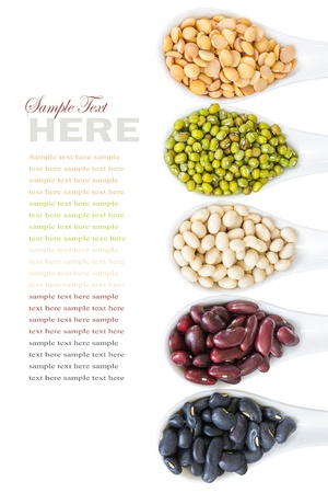 different beans in white spoon isolated on white photo