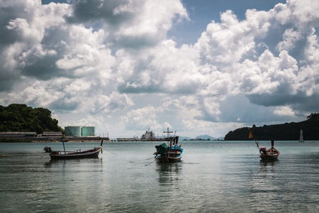 fishing boat on the sea with cloudy blue sky photo