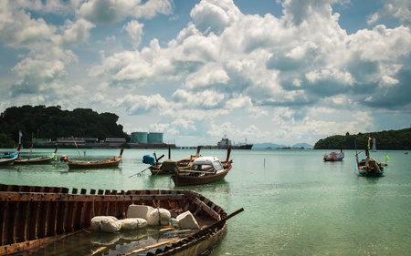 many fishing boat on the sea with cloudy sky in the morning photo