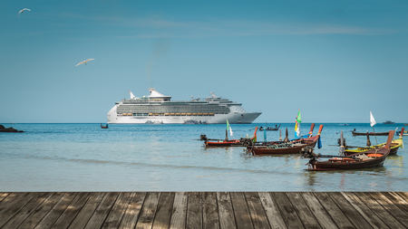 scenery of patong beach with long tail boats and luxury cruise on andaman sea, thailand photo