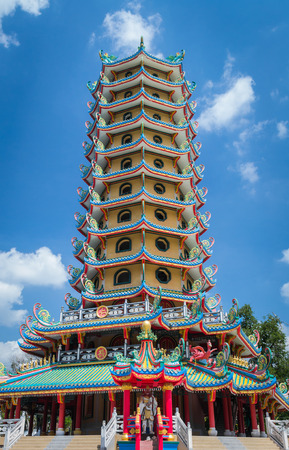 chinese pagoda in the temple with cloudy blue sky, krabi, thailand photo