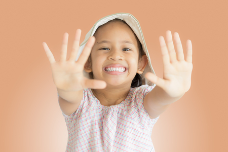 no teeth smile: isolated little cute girl smiling and showing hers palms Stock Photo