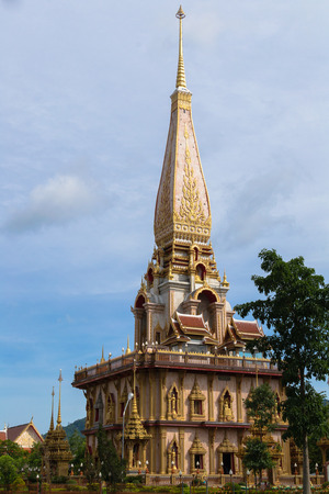 chalong: holy pagoda at chalong temple with cloudy blue sky, Phuket, Thailand