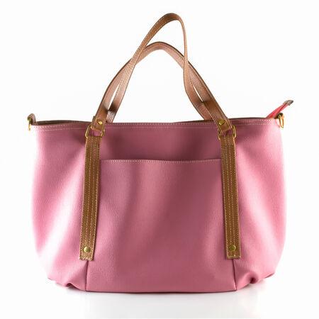 leren tas: roze kunstmatige lederen tas op wit wordt geïsoleerd Stockfoto