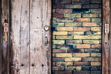 crazed: Old wooden plank on the brick wall background