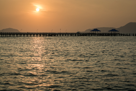 shinning light: Scenery of Rawai pier with rising sun in the early morning, Phuket, Thailand