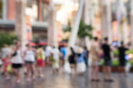 Abstract of blurred people walking in the shopping mall photo