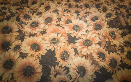 Close up artificial sunflower on old paper background photo