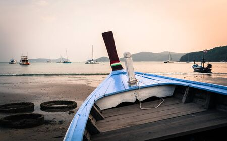 wooden boat: Close up a blue wooden boat on the beach during low tide Stock Photo