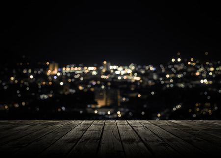 View from wooden plank above phuket town at night Standard-Bild