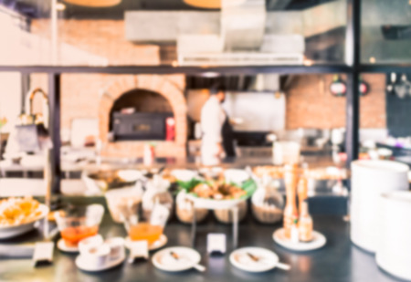 western food: Abstract of blurred western kitchen with food preparing