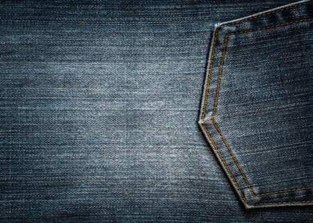 jeans: Blue denim background of rough cloth
