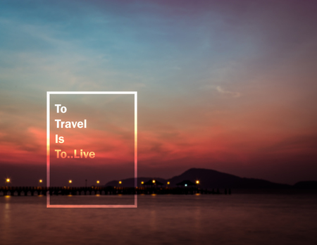 wymowny: Meaningful quote on blurred seascape during sunrise background, to travel is to live
