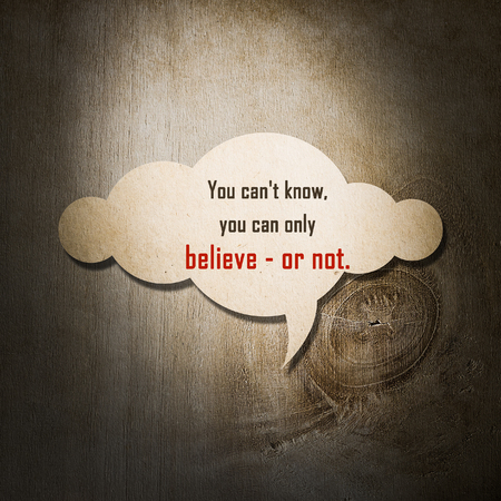 wymowny: Meaningful quote on paper cloud with wooden background, You cant know, you can only believe or not.