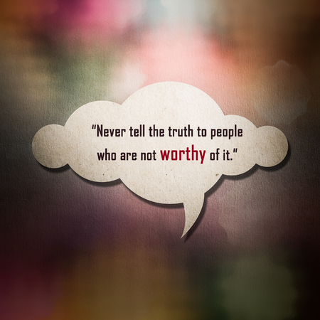 worthy: Meaningful quote on paper cloud with colorful bokeh background, Never tell the truth to people who are not worthy of it. Stock Photo