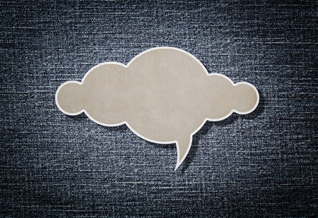 Cloud paper on blue denim background for your text Imagens