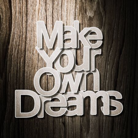 meaningful: Meaningful word on old grunge wood background, Make your own dreams.
