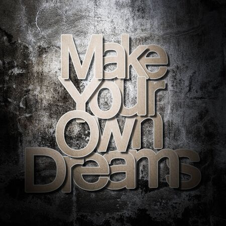 meaningful: Meaningful word on old grunge concrete background, Make your own dreams.