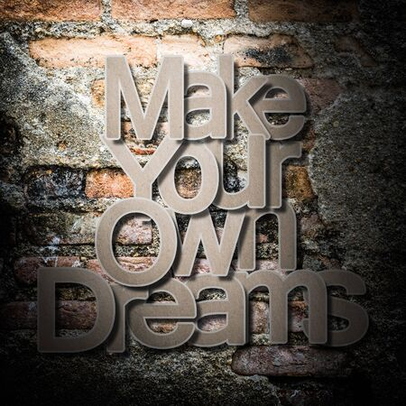 meaningful: Meaningful word on old brick wall background, Make your own dreams. Stock Photo