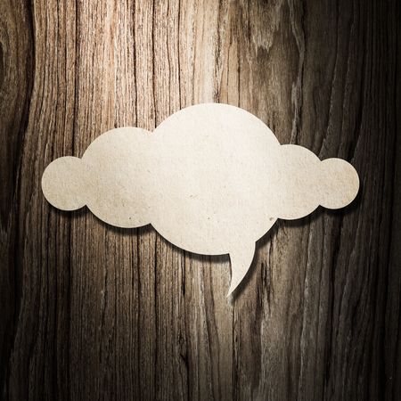 design thinking: Cloud paper on wooden background for your text