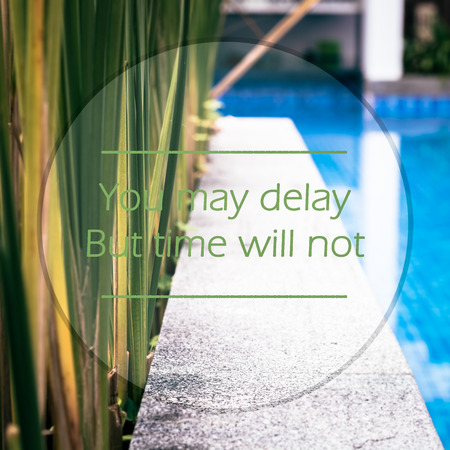 meaningful: Meaningful quotes on swimming pool background, You may delay But time will not. Stock Photo