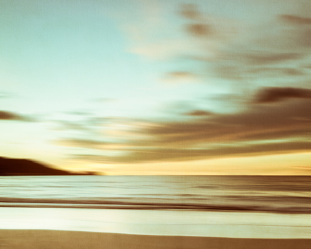 nature scenery: An abstract seascape with blurred panning motion with cross-processed colors on paper background