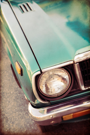 front side: Front side of green old car in vintage style background Stock Photo