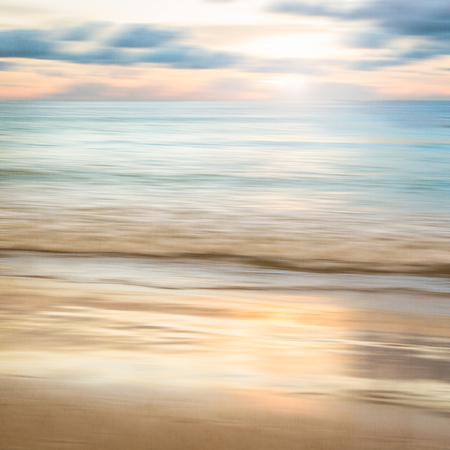 An abstract seascape with blurred panning motion with cross-processed colors on paper background