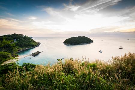 ocean sunset: Tropical ocean landscape with a little island under dramatic blue sky, Phuket, Thailand Stock Photo
