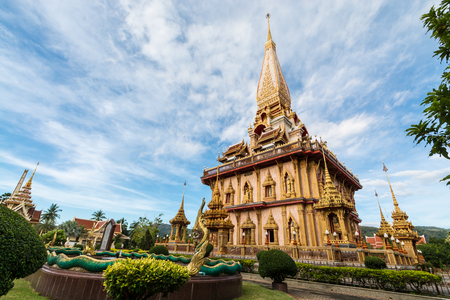 chalong: Holy pagoda in chalong temple under cloudy blue sky, Phuket, Thailand Stock Photo