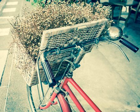 basket: Retro bicycle with flower in the wooden basket vintage tone Stock Photo