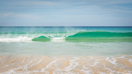 wavelet: Moving of surf in the sea under cloudy blue sky