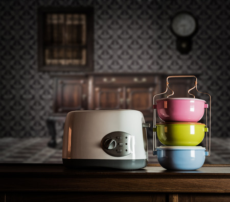 Colorful tiffin carrier and electric toaster on wooden cupboard with vintage interior