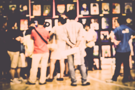 exhibition crowd: Blurred crowd of people watching art exhibition in the hall for background