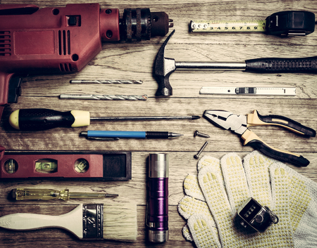 numerator: Set of tools over a wooden plank in vintage background Stock Photo