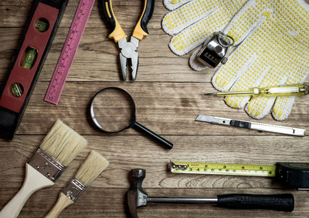 Set of tools over a wooden plank background