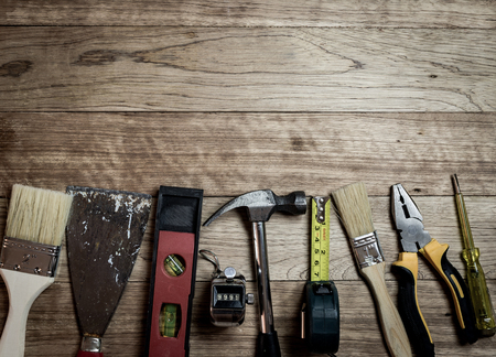 numerator: Set of tools over a wooden plank background
