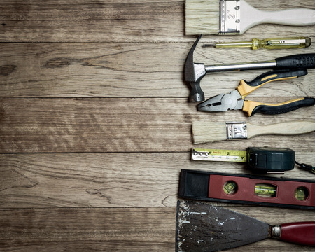 manual measuring instrument: Set of tools over a wooden plank background