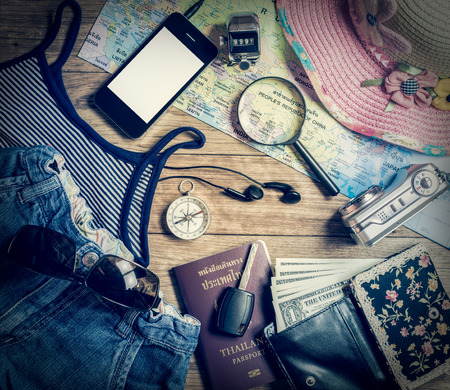 numerator: Set of travel accessory for female with mobile phone on wooden vintage background